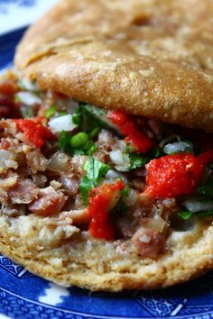 Mexican gordita. a thick cake of masa and lard, often topped with cheeses, or meats