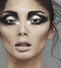 Beautiful model with dramatic black and white eyes. Try the look with Ben Nye Pressed Eye Shadows ($10.00), camerareadycosmetics.com