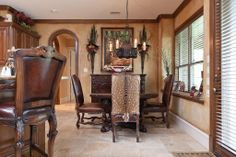 Breakfast room features upgraded chandelier and looks out onto the inviting summer kitchen.