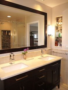 Small master bathroom with light in niche and coordinating large niche in shower.