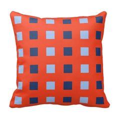 Modern light and dark cobalt blue squares on red pillows