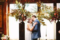 ceremony kiss - photo by Pat Furey http://ruffledblog.com/brooklyn-wedding-with-breathtaking-floral-design