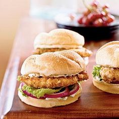 These reduced-fat chicken sandwiches feature chicken cutlets encrusted with tortilla chip crumbs, which yield a satisfying crunch. You can also use spicy chips for more heat.