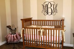 pink beige brown baby girl nursery crib. The grandfather made the crib with wood he purchased after a tornado destroyed them in TN. What craftmanship!