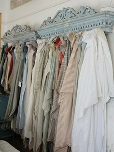 linens - I love this idea!!! Old pediments used as a display for ANYTHING!