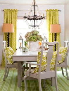 love it all!  would be super cool with the orange fabric and zebra stripe combo....love the lamps in front of curtains