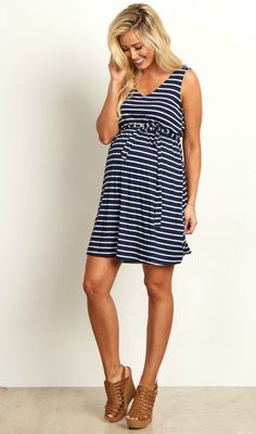 We love this maternity dress that has all out favorite details. A v-neckline and sash tie detail with a striped print will beautifully show off your bump this year. A pretty draped back is what really sets this maternity dress apart from the rest. Put on some strappy sandals and you're ready to step out in style.
