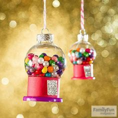 Roll a 3/4- by 5-inch strip of card stock into a 1 1/4-inch-diameter tube and secure it with tacky glue (clamp it with a clothespin until the glue dries). Glue one end of a small rectangle of silver glitter card stock to the tube. Fill a 1 1/2-inch-diameter clear glass ball ornament with small beads. For the base, glue the tube to a large button (ours has a 1 1/2-inch diameter), then glue the ornament in place