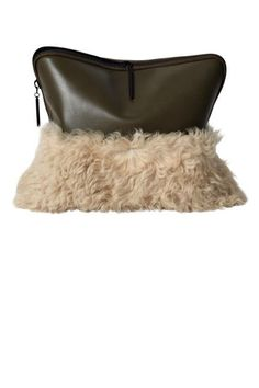THE POUCH This season's shearling and fur embellished pouch iterations make this slouchy silhouette the ultra-cool day time clutch.  3.1 Phillip Lim Leather and Shearling Clutch