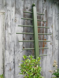 Garden Trellis 7' 6. No longer available on etsy, but looks to be a newel post drilled through with dowel rods.  Good lookin' trellis!