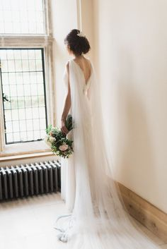 Bride in Cherry Williams Gown & Cape | Romantic Blush Wedding Inspiration by The Wedding Stylist at Notley Abbey with Joanna Truby Flowers | Emma Pilkington Photography | Opaline Films