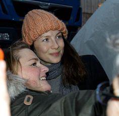 Caitriona poses for a snap with fan