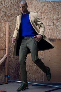Malik wears shoes Burberry Prorsum, jacket and sweater Sandor, pants and pin Club Monaco.