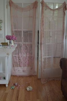 Vintage pink lace curtains covering French doors.