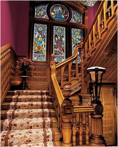 Victorian staircase with stained glass window
