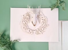 Our Stag card makes a beautiful addition to anyone's holiday season 🎁 . . . . #uwpluxe #givingseason #diecut #lasercut #snailmail #holidaycheer #popup #popupcard #stag #deer #reindeer #floral #wreath #paperengineering #christmas #holidays #christmas2016 #gifts #giftideas #paper #paperart #design #stationery