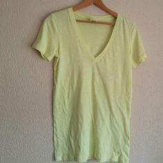 Victoria's Secret PINK hot yellow t-shirt Victoria's Secret PINK hot yellow t-shirt. Light wear size medium. There is a faint stain that can be seen in picture 4 it is on the upper left side of shirt.(tried to capture in photo). Still in good condition. Super cute light weight t-shirt. No trades. Victoria's Secret Tops Tees - Long Sleeve