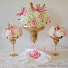 "suggest using a ""pure"" palette of white and ivory floral varieties with accents of pale pink and yellow – I used white hydrangeas, mini calla lilies, and carnations with accents of pale pink tulips, carnations, and lilies"