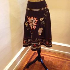 "Beautiful Swing Skirt by Sunny Leigh Embroidered all around beautifully chosen colors of green, orange, cream an array of colors on dark chocolate skirt. 36"" wrist and 26 1/2"" in length from wrist to hem. Zipper on side. Vintage Skirts"