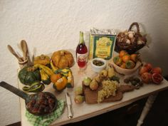 dollhouse Miniature table set up with the fruits of autumn