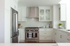 HGTV's Love It or List It, Too host and designer Jillian Harris transformed the former dining room into an adorable new kitchen, complete withstainless steel appliances, dazzling white cabinets and a stunning dual-toned backsplash.
