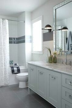 """combine elongated white subway tiles with a double band of 1"""" x 1"""" glass mosaics surrounded by a second double band of 4""""x 4"""" square ceramic tiles."""