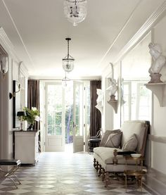 Wow. This is a foyer. wow. And don't we love seeing the backyard from the front of the house? So important. Love it.