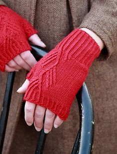 Twisted Stitch Mitts  by Amy McElwain    Published in  Classic Elite Yarns Web-Letter  free knitting pattern