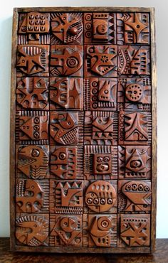 This is made by artist Evelyn Ackerman and done on wood wall panel. I really like this piece. I like the repeated square pattern where each square has carved its own figure
