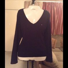 "Tommy Hilfiger Top Tommy Hilfiger Top is made of 100% Cotton. The Size is Large. The color is Blue. Long sleeve design. This top is comfortable and stylish. Laying flat ""17. Arm Length ""19. Length of Top ""24. This item is in Good condition, Authentic and from a Smoke And Pet free home. All Offers through the offer button ONLY. I Will not negotiate Price in the comment section. Thank You😃 Tommy Hilfiger Tops"