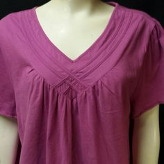 """2x-3x Kim Rogers top This is a different twist to an ordinary T-shirt, it has criss cross across the chest. (actual color pic#1). It's 100%cotton with LOTS of stretch! Has been worn 2-3x still in EXCELLENT condition! It's 28.5"""" long, 56"""" bust & belly, 60"""" around the bottom. This came from an animal and smoke free home, however mine is not (it's been in a tote since I've had it). I wash everything before mailing it   I am a FAST shipper!   PayPal Kim Rogers Tops Tees - Short Sleeve"""