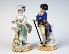 Meissen figure of a lady passing the time by playing cards.