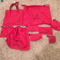 NWT Mickey Mouse Bag Set Mickey Mouse carry bag with 8 drawstring bags for organizing labeled little stuff, more stuff, two her stuff, zippered His stuff, extra stuff, medium our stuff and a large big stuff that all goes in a carrying bag with nylon handles. Disney Bags Totes