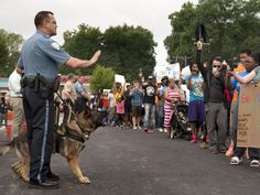 Police try to quell protesters during a rally Aug. 10 against the shooting of Michael Brown, 18, by police in Ferguson, Mo. (Photo: Sid Hastings, AP)