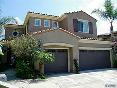San Clemente, French gray stucco, dark gray accents with off white trim, tile roof