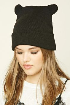 A ribbed knit beanie featuring bear ears and a fold-over design.