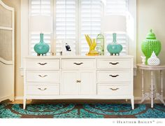 Heather Bailey did such a great job giving this dresser a fresh look. Love the colors in the room.