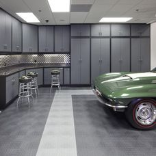 God knows that garage shelving was not cheap, but man he would be speechless if he came to that! - modern garage and shed by Dave Brewer Homes