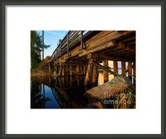 "Wooden Bridge And The Sunset In Kangaslampi / Finland by Ismo Raisanen. The watermark (""Fine Art America"") doesn't appear in the print you buy. Framed Art, Framed Prints, Hanging Wire, Prints For Sale, Finland, Fine Art America, Bridge, My Arts, In This Moment"