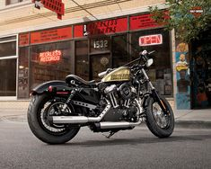 2013 Harley 48 - I'm not keen on the graphics but the 50's style seat and Hollywood bars look cool.