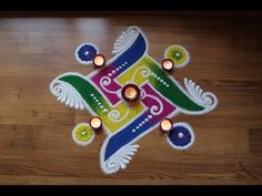 swastik small rangoli designs with colours by Shital Daga Easy Rangoli Designs Videos, Rangoli Designs Simple Diwali, Rangoli Simple, Indian Rangoli Designs, Rangoli Designs Latest, Rangoli Designs Flower, Free Hand Rangoli Design, Rangoli Border Designs, Small Rangoli Design