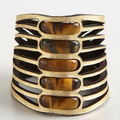 "Daniela Zagnoli Tigers Eye Cuff Left over from my boutique- this is a gold and leather cuff with embedded tigers eye. This measures 3"" wide and has a read magnetic closure. Daniela Zagnoli Accessories"