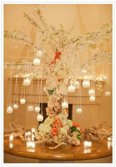 "love these table ""trees"" with hanging candles and floral trunks"
