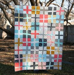 Wonky Cross Quilt by QuiltsByEmily, via Flickr