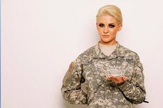 Miss Kansas Theresa Vail, the tattooed Army sergeant. As an American soldier, she believes that with the experiences that she has gone through, she would really become a role model of the women in this nation. Being Miss America requires the same trait as being a soldier. She gives the impression that being Miss America doesn't just involve being pretty, intelligent, and talented in a feminine way, but also with the desire to give and help the nation by sacrificing herself. Yi-Shan C.