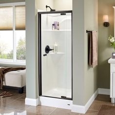 Delta Lyndall 31 in. x 66 in. Semi-Frameless Pivot Shower Door in Bronze with Clear Glass