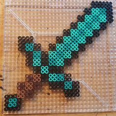 Minecraft perler beads by  the_nerdy_girl_crafter