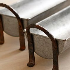 Three potato four...galvanized steel baguette trays in several sizes. So great for displaying fruit, pears and apples, etc., maybe even as a planter for succulents. Oh, and then you could also use it for...banquettes and bread!