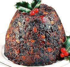 Quick and easy Christmas pudding recipe (or plum pudding). This us the easiest recipe I've seen for a plum pudding. Steam/cook in a crockpot and use a bundt pan ilo a pudding tin for even easier cooking. Christmas Deserts, Christmas Goodies, Christmas Traditions, Christmas Recipes, Xmas Pudding, Chia Pudding, Irish Christmas Pudding Recipe, English Christmas Pudding, Banana Pudding