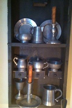 Pewter in old key cabinet